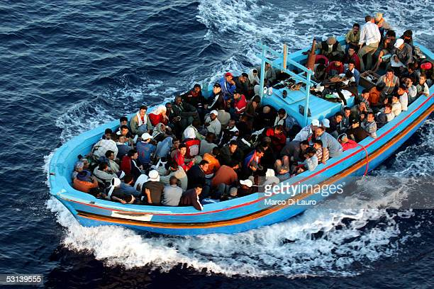 A boat loaded with illegal immigrant is seen on June 21 2005 in Lampedusa Italy Tens of thousands of immigrants land on the Italian coast each year...