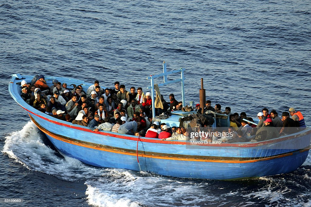 A boat loaded with illegal immigrant is seen on June 21, 2005 in Lampedusa, Italy. Tens of thousands of immigrants land on the Italian coast each year, most of them heading from north Africa on ramshackle boats.In the Mediterranean Sea between Malta and Tunisia, Lampedusa Island is one of the main gateways for illegal immigration from Africa into Europe. According to a report by Amnesty International, Illegal immigrants who land in Italy consistently allege they have been abused, holding centres are overcrowded and no legal assistance is offered. Italian authorities refused to give access to the centres to enable further investigations by Amnesty. The Amnesty International report says 15,647 people were held in the centres in 2004: a 9 per-cent increase on the previous year.