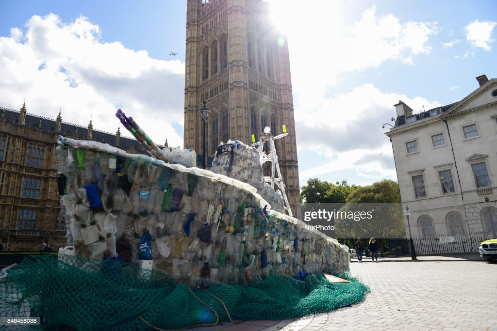 A boat made of plastic bottles, is seen outside the Parliament, in London on September 13, 2017. The boat has been built by the members of 'Surfers Against Sweage' to show the increasing amount of plastic in the seas.