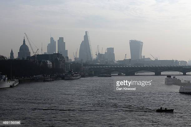 A boat makes its way across the Thames through smog on April 10 2015 in London England Air pollution and smog has blanketed much of central and...