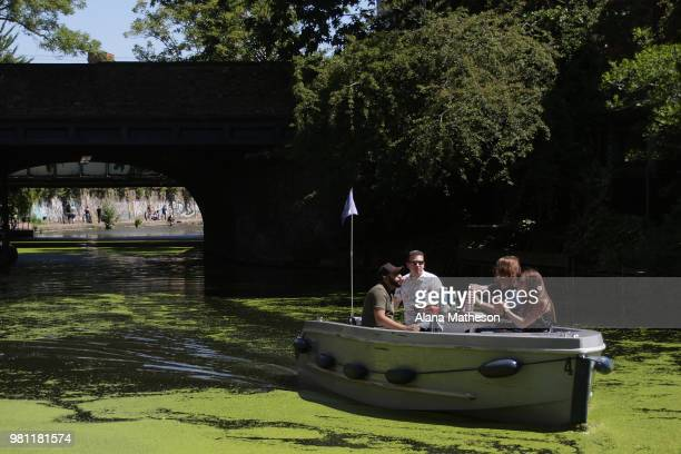 A boat makes its way along Regent's Canal on June 22 2018 in London England Much of the UK is expected to enjoy seasonable weather this weekend with...