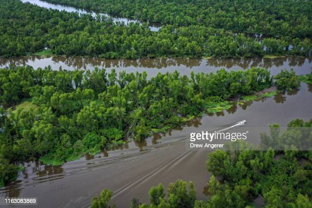 A boat makes its way along the Atchafalaya River in the Atchafalaya Basin the largest wetland and swamp in the United States on August 21 2019 in...