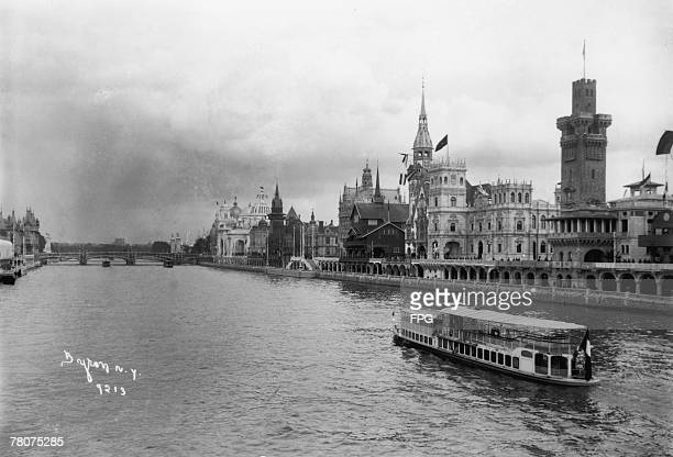 A boat makes its way down the Seine during the Exposition Universelle Paris 1900 The German Pavillion can be seen centre right