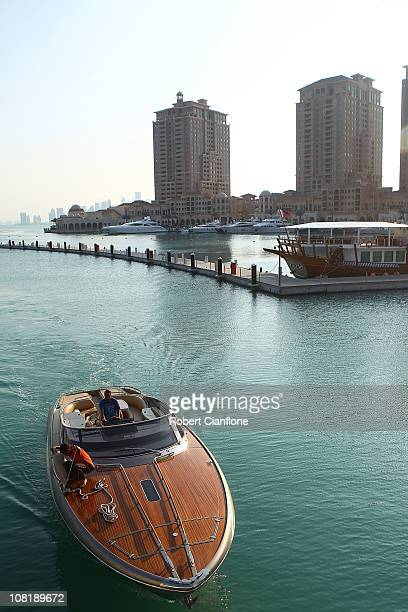 A boat makes its way inot the harbour at The Pearl Qatar in Doha on January 20 2011 in Doha Qatar