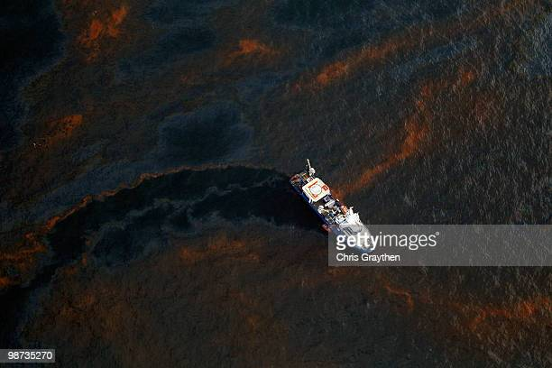 A boat makes its way through crude oil that has leaked from the Deepwater Horizon wellhead in the Gulf of Mexico on April 28 2010 near New Orleans...