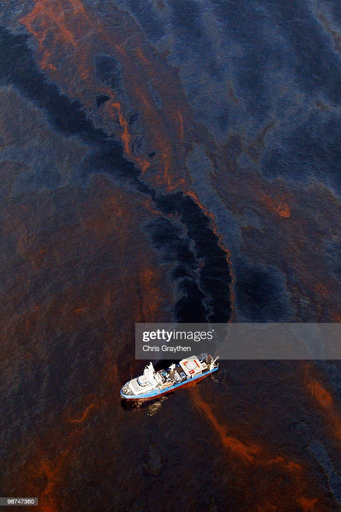 A boat makes its way through crude oil that has leaked from the Deepwater Horizon wellhead in the Gulf of Mexico on April 28, 2010 near New Orleans, Louisiana. An estimated leak of 1,000 barrels of oil a day are still leaking into the gulf.