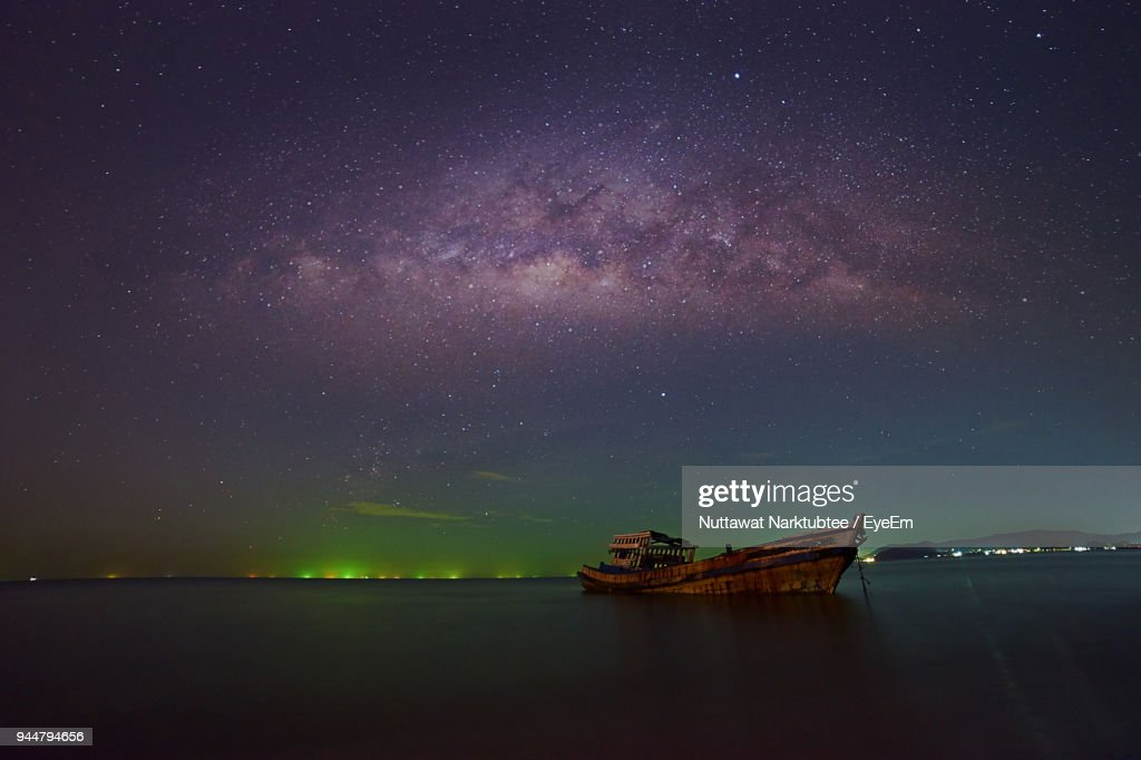 Boat Moored Against Sky At Night : Stock Photo