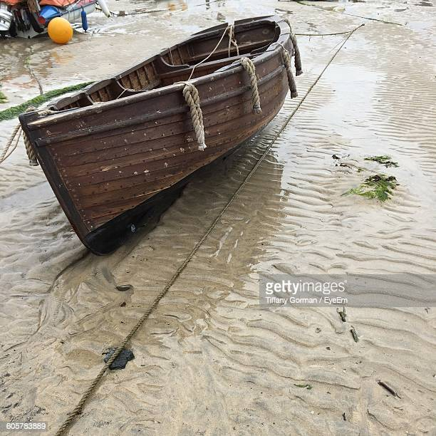 boat moored at beach - st ives stock pictures, royalty-free photos & images