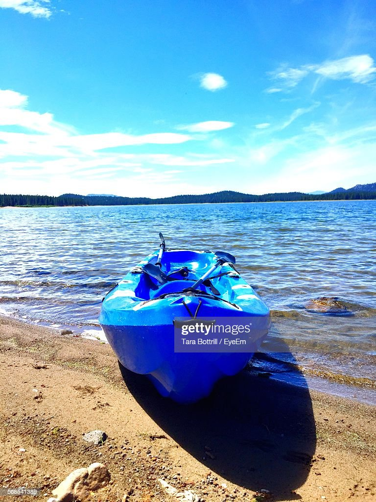Boat Moored At Sea Shore Against Sky : Stock Photo