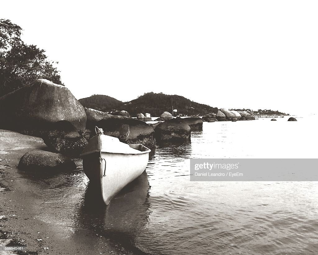 Boat Moored At Shore Against Clear Sky : Stock Photo