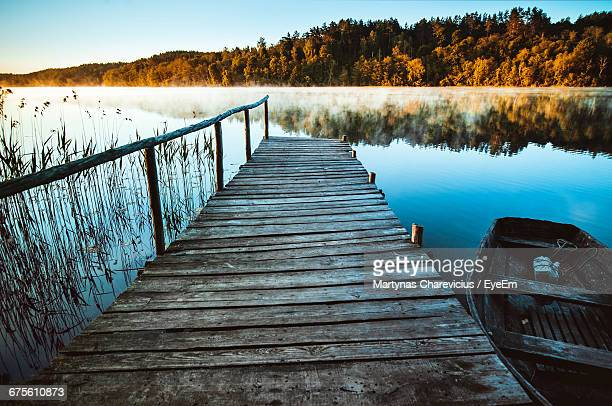 Boat Moored By Jetty In Lake