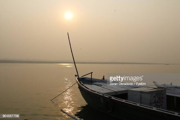 Boat Moored In Sea Against Clear Sky During Sunset