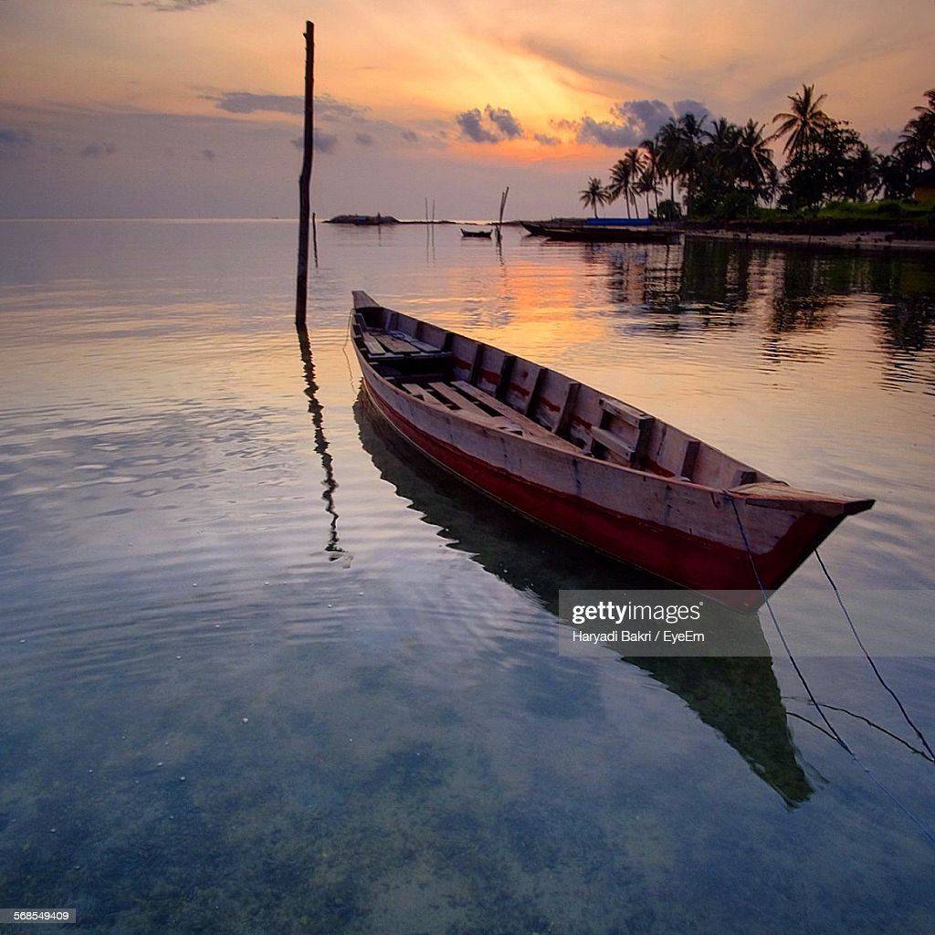 Boat Moored In Sea Against Sky During Sunset : Stock Photo