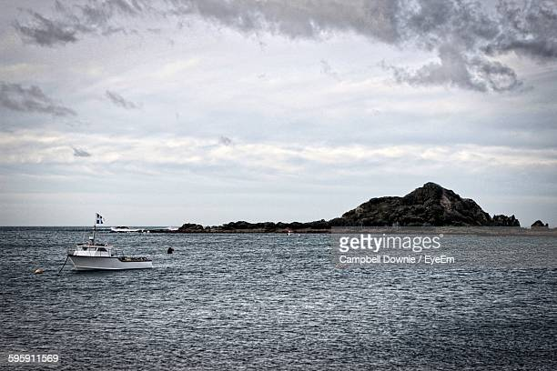 boat moored in sea against sky - campbell downie stock pictures, royalty-free photos & images