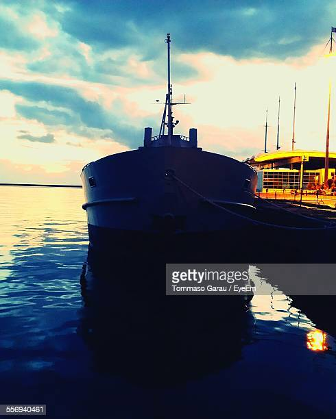 Boat Moored In Sea At Sunset