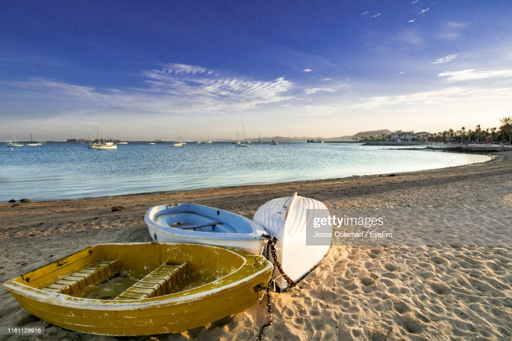 Boat Moored On Beach Against Sky : Stock Photo