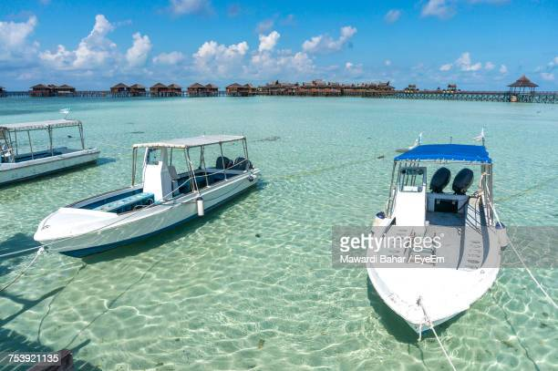 boat moored on beach against sky - sabah state stock pictures, royalty-free photos & images