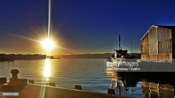 Boat Moored On Lake During Sunset