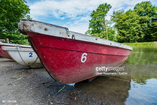 Boat Moored On Shore Against Sky