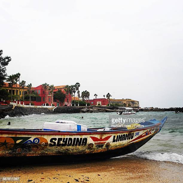 Boat Moored On Shore In Goree Island Against Clear Sky