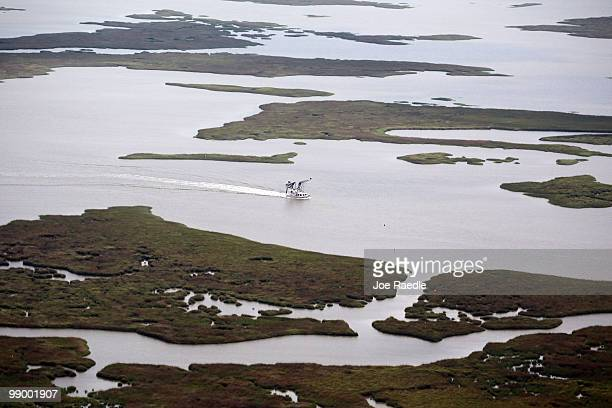 A boat moves through the marshland in the southwest region of Louisiana as the government tries to protect the coastline from the massive oil spill...