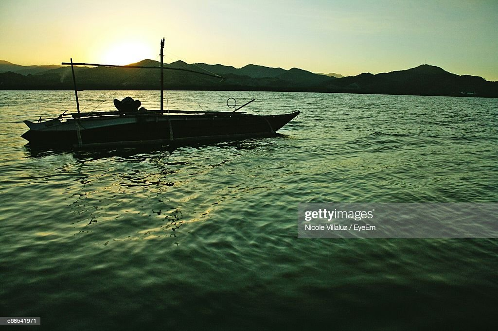 Boat Moving On River Against Clear Sky : Stock Photo