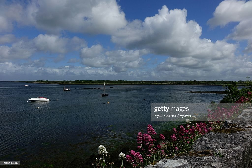 Boat Moving On River Against Cloudy Sky : Stock Photo