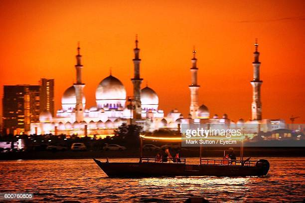 Boat Moving On River In Front Of Sheikh Zayed Mosque During Sunset