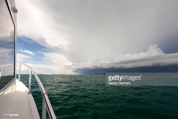 Boat moving toward thunderstorm in Gulf of Mexico, Anna Maria Island, Florida, USA