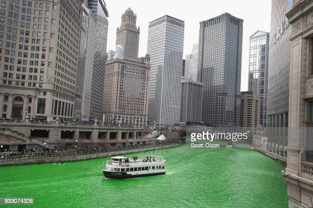 Boat navigates the Chicago River shortly after it was dyed green in celebration of St. Patrick's Day on March 17, 2018 in Chicago, Illinois. Dyeing...