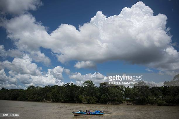 Boat navigates the Guayabero river before the arrival of Prince Charles of Wales and Colombian President Juan Manuel Santos to La Macarena, Meta...