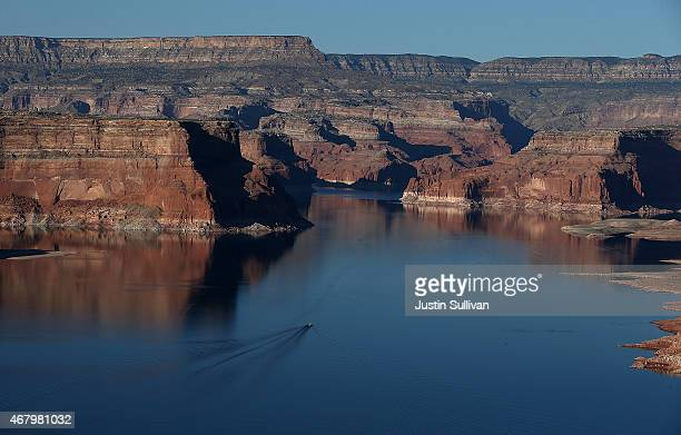 A boat navigates the waters of Lake Powell on March 28 2015 in Lake Powell Utah As severe drought grips parts of the Western United States a below...