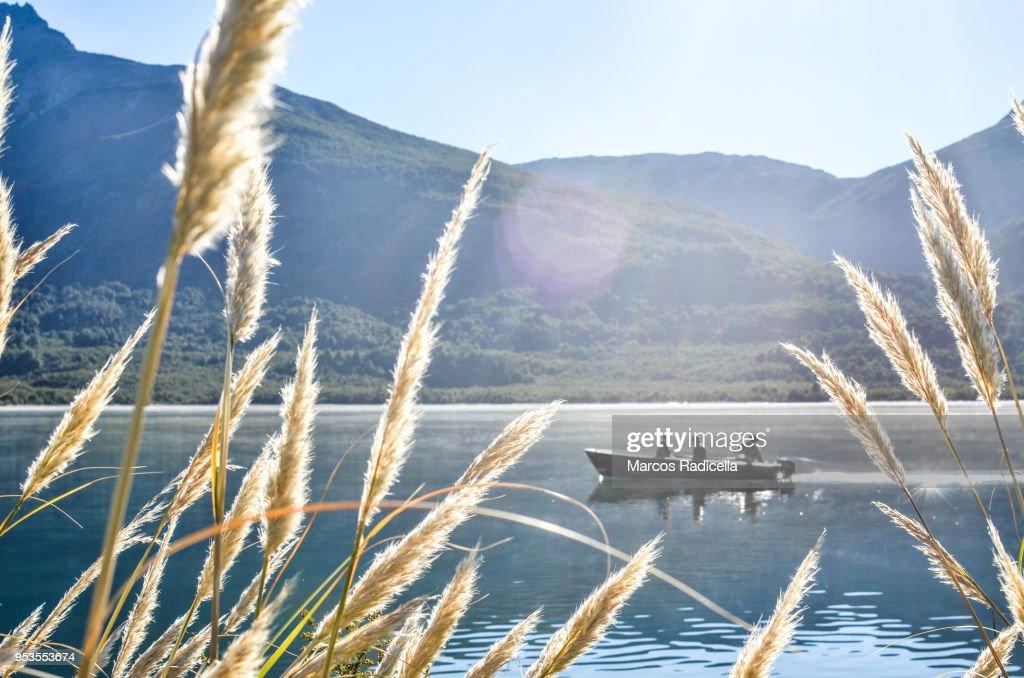 Boat navigating lake in Patagonia : Stock Photo