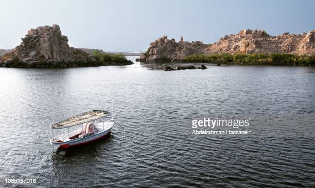 boat near an island at the nile river - aswan stock pictures, royalty-free photos & images