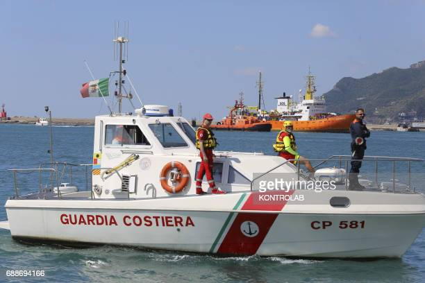 A boat of Coast Guard during stages of landing from the Ship Acquarius of ItalianFrancoGerman humanitarian organization «Sos Mediterranee» in...