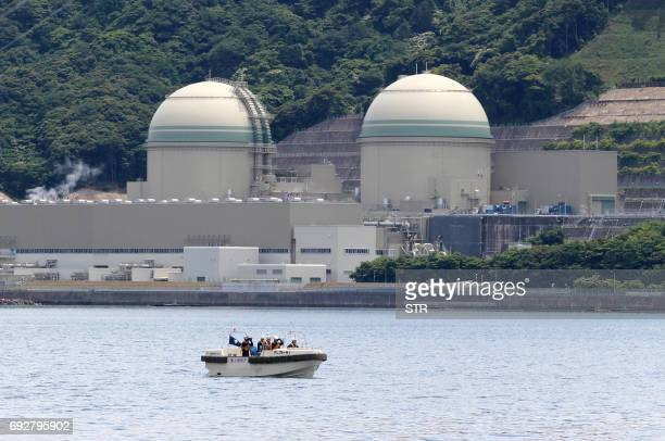 A boat of the Japan Coast Guard patrols in front of the No 3 reactor at the Takahama nuclear plant in Takahama Fukui prefecture some 350 kilometres...