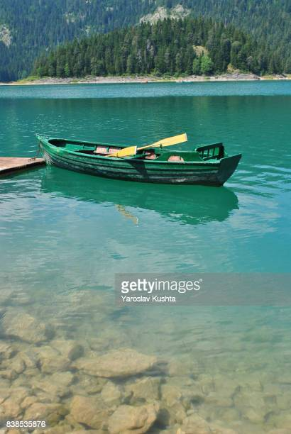 A boat on a black lake in Montenegro