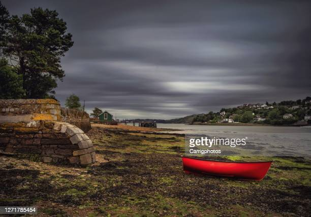 boat on beach, currabinny woods, county cork, ireland - overcast stock pictures, royalty-free photos & images