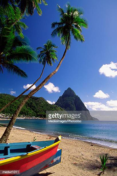 boat on beach near pitons at souffriere, saint lucia, caribbean - st. lucia stock pictures, royalty-free photos & images