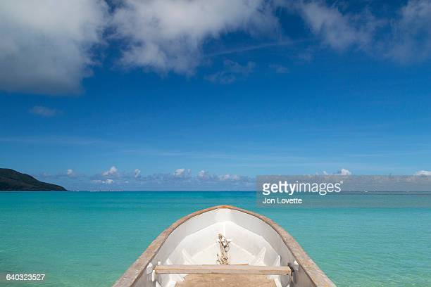 boat on blue lagoon in fiji - western division fiji stock photos and pictures