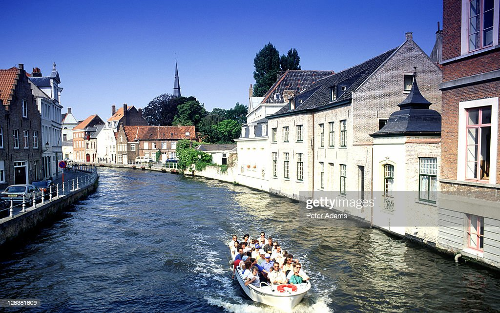 boat on canal bruge belgium stock photo