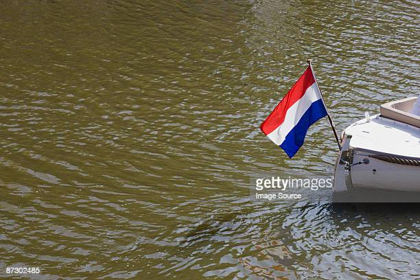 Boat on canal with dutch flag
