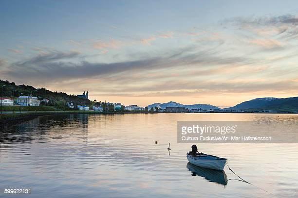 Boat on fjord and town of Akureyri, Eyjafjordur, Iceland