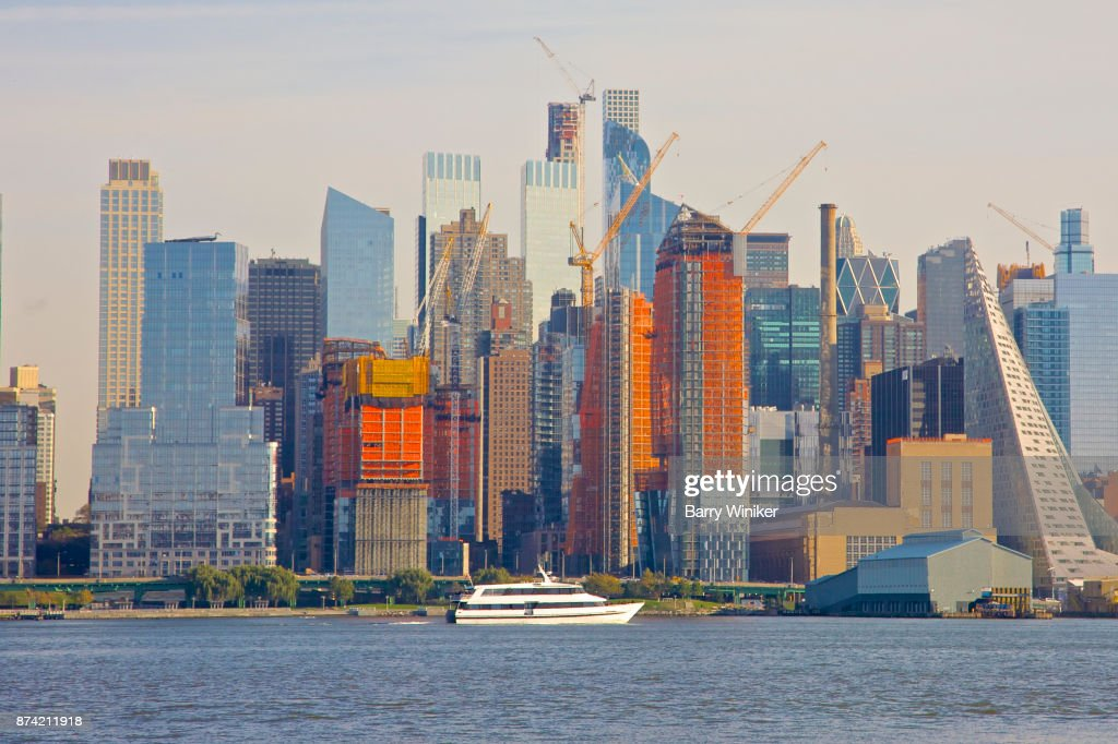 Boat on Hudson River near towers of Midtown West, Manhattan, seen from New Jersey : Stock Photo