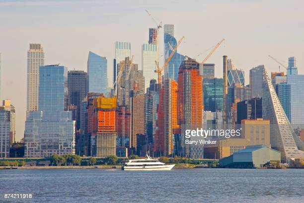 Boat on Hudson River near towers of Midtown West, Manhattan, seen from New Jersey