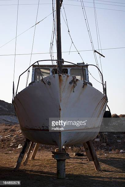 Boat on land in need of repair