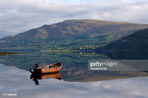 boat on loch broom - lake stock pictures, royalty-free photos & images