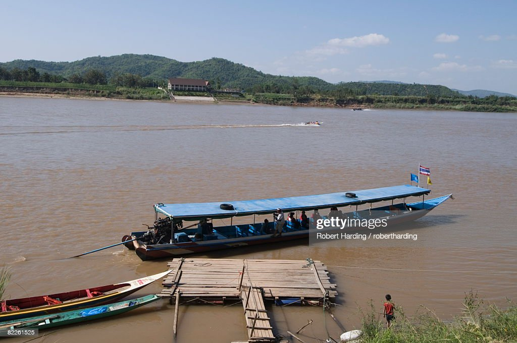 Boat on Mekong River, taken from Laos to Thailand on the opposite bank, Laos, Indochina, Southeast Asia, Asia : Stock Photo