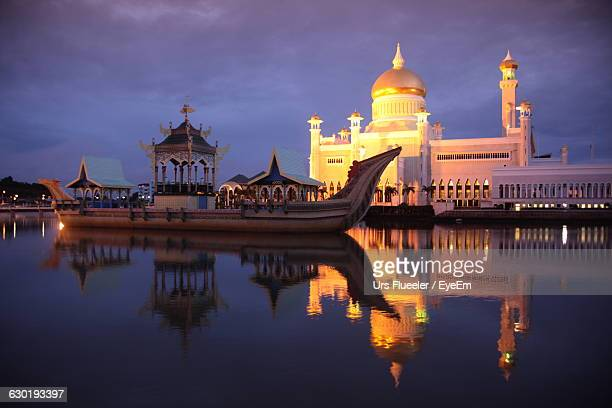 Boat On Pool At Illuminated Sultan Omar Ali Saifuddin Mosque