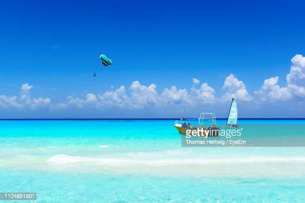 boat on sea against blue sky - quintana roo stock pictures, royalty-free photos & images
